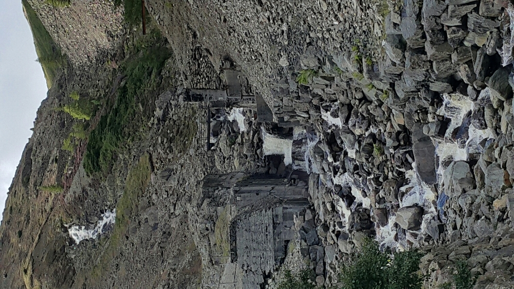 Wow, finally made it to the bottom. This is an old slate quarry.