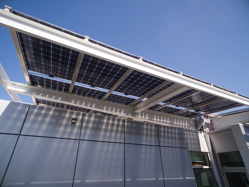 The bifacial solar panels at Jacobs Hall are frameless and partially transparent to allow sunlight to reach the undersides of the panels.