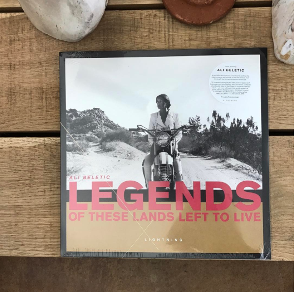 """LEGENDS OF THESE LANDS LEFT TO LIVE Vinyl Available. Also, available digitally via iTunes, Spotify, Tidal. Read Reviews by NPR, STEREOGUM, VICE/NOISEY, and others on music page.    """"AN ANTHEM FOR THE REBEL IN ALL OF US""""  - THE REVUE, CA   """" Beletic's debut album, Legends of These Lands Left to Live, takes its emotionally raw energy from the wells of transformation and mystery. At times, the record recalls Patti Smith's ragged and desperate punk, the Flat Duo Jets' animalistic rockabilly played super slow, or Cat Power's cigarette-chewing soul — yet, even with such high-profile reference points, Beletic holds her own ... Ali Beletic's Debut is one of the most refreshing rock albums I've heard in a while."""" -    LARS GOTRICH, NPR     """"HOLY SHIT, I KNEW LONG BEFORE I HEARD  DEAD SERIOUS  THAT  LEGENDS…  WAS GOING TO BE ONE OF THIS YEARS BEST, BUT THAT SONG SEALED ITS FATE AS ONE OF THE BEST ALBUMS I'VE EVER REVIEWED.""""  - BRIAN SNIDER, SECRETLY IMPORTANT  """"The song is sparse and concentrated, with the alternating strum and wail of two guitars, later a subdued piano—even as it builds to a crashing chorus it refuses to scatter, instead garnering a terrifying concentration not too far off from Patti Smith's growling fury and triumph on Horses. The heartfelt line """"We've lived so well"""" sinks deeper with each reiteration and each breath between, and it's hard not to be swayed. """"  - Amelia Pitcherella,     Impose   """"IT'S RARE THAT WE REMEMBER TO TAKE A BREATHER, AND BE SILENT, WHICH IS WHY ARTISTS WHO PROMPT YOU TO DO THAT CAN OFTEN BE SOME OF THE BEST...THE RESULT HARNESSES THE DETERMINATION OF PATTI SMITH, THE DARK DRAWL OF CAT POWER, AND THE BEATNIK HOME-IS-WHERE-MY-HARMONICA-HOLDER-IS VIBE OF EARLY BOB DYLAN.""""  - EMMA GARLAND, VICE/NOISEY"""
