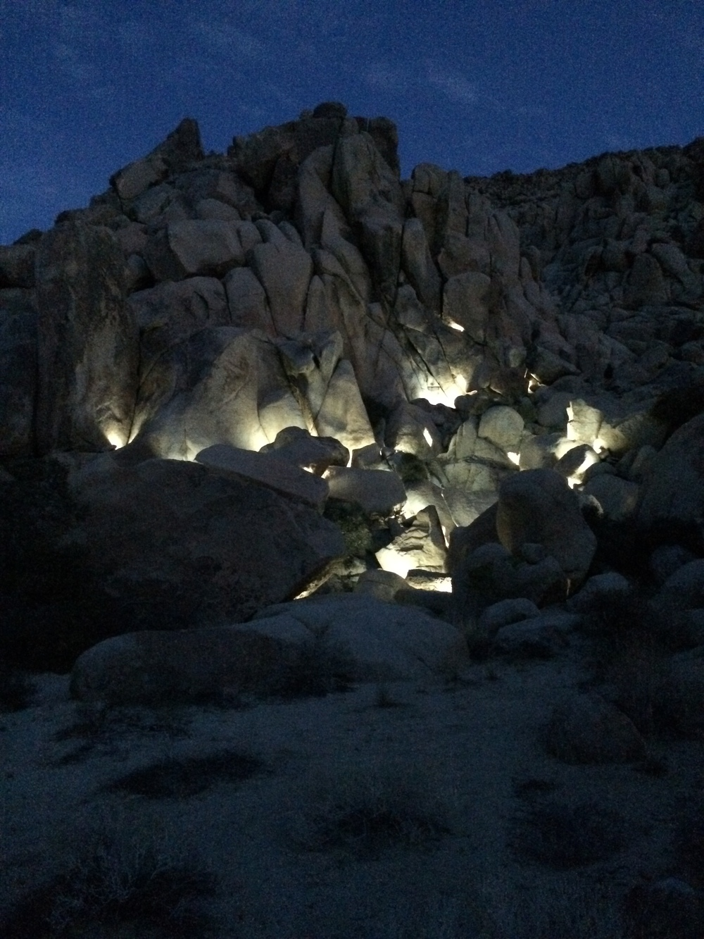 Illuminated Passage  Light 1/4 Square Mile    Exhibition: Joshua Tree Triennial, Boxo Projects  Invited to create a site specific sculpture for the Joshua Triennial curated by Metacurator and Boxo Projects. I built a Light Sculpture into the boulder field for invitees to hike through. The sculpture revealed itself as the sun set. Installed at Boxo Projects in Joshua Tree as part of the Joshua Tree Arts Festival curated by Boxo Projects and Metacurator.