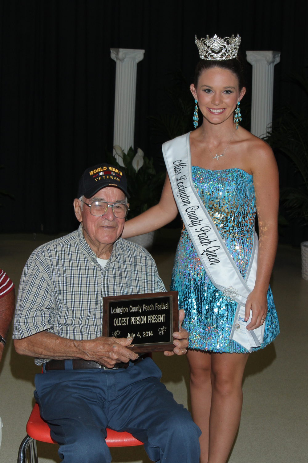 George Oswald, a World War II army veteran and the 2014 Grand Marshal with 2013 Lexington County Peach Queen Micaela Campbell.