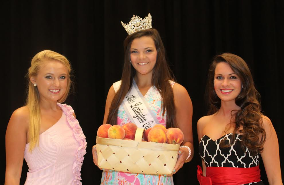 2014 Peach Queen Kaylee Cuthbertson, with two of the 2015 contestants; left to right, Jamie Vaughn, Reigning Peach Queen Kaylee Cuthbertson, and Lindsey Roof.