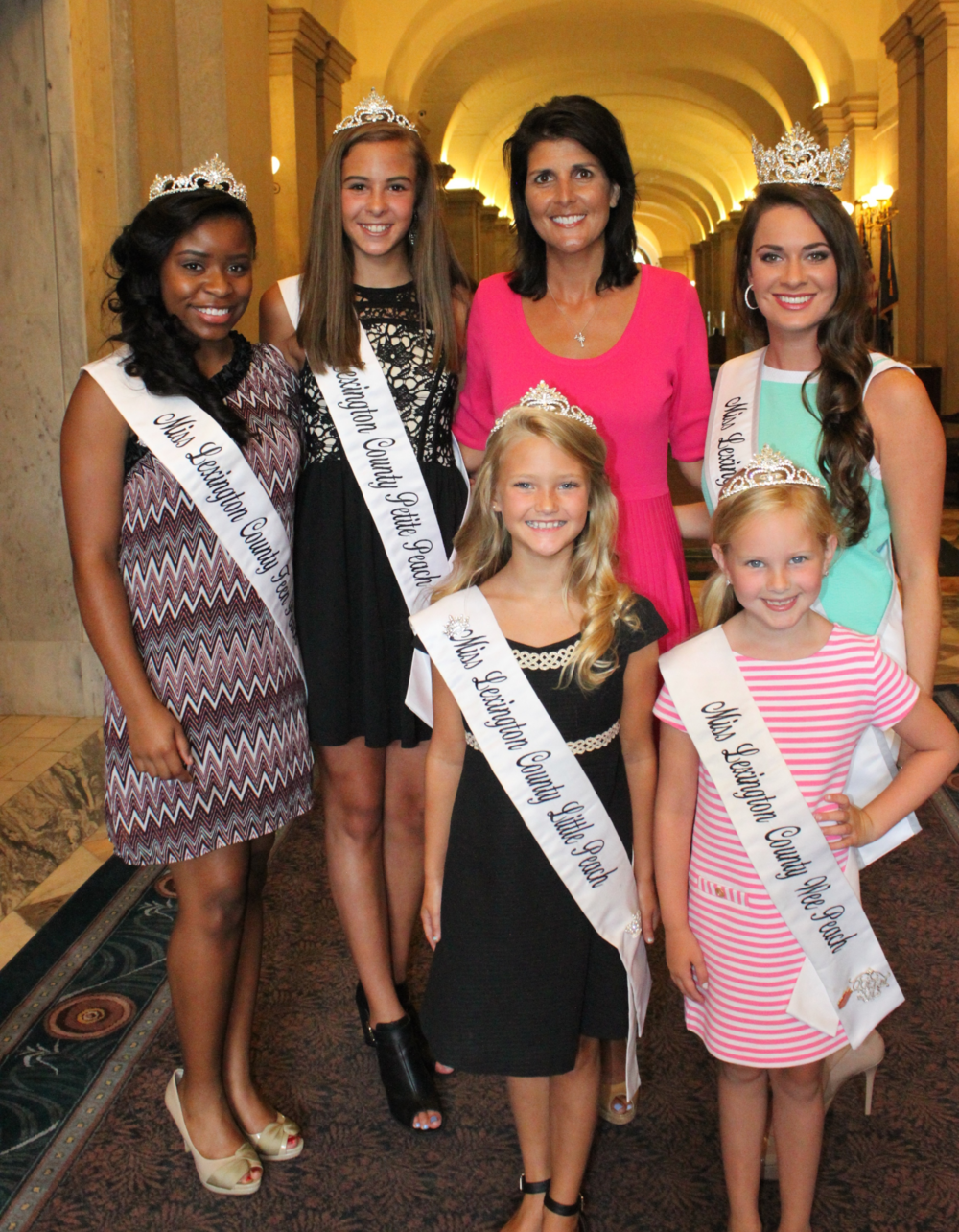 2015 Peach Queens and Governor Haley, left to right:  Cicely Deatrice Wise, Haley Noelle Heustess, Sarah-Katherine Nicole Cantrell, Governor Nikki Haley, Annalee Victoria Compton, and Lindsey Morgan Roof.