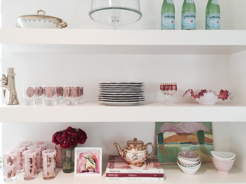 My open kitchen shelving: featuring Grandmama Kathleen O'Connor's teapot,  Donna Hay  cookbooks, vintage glassware, and Limoges tureen.