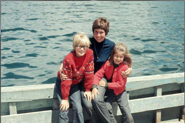 Crossing Lake Titicaca, Peru, with my mom and my big brother.  I'll never forget the floating islands and the people.