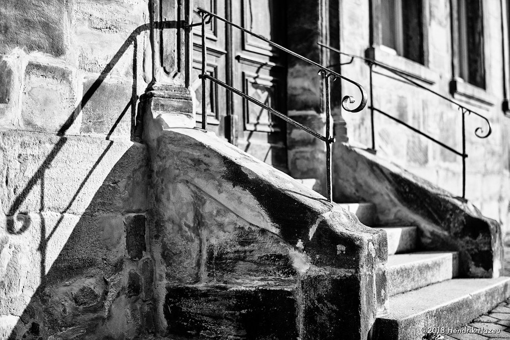 Stairs leading to old townhouse entrance, 58mm f/1.4 @f/2