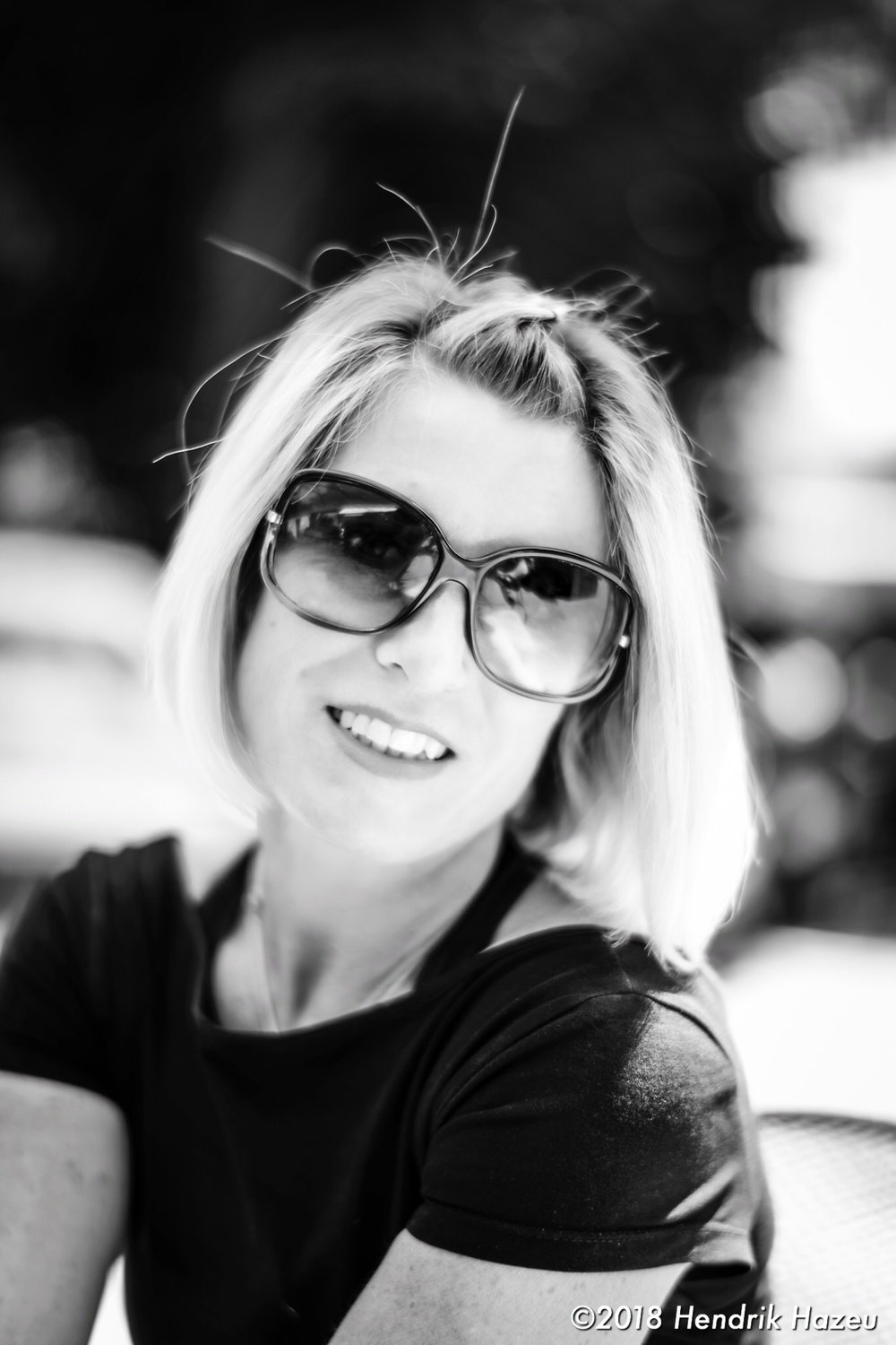 Focused on the rim of my pretty wife's sunglasses, Nikon 58mm f/1.4 @f/1.4, 1/500 sec, 64 ISO