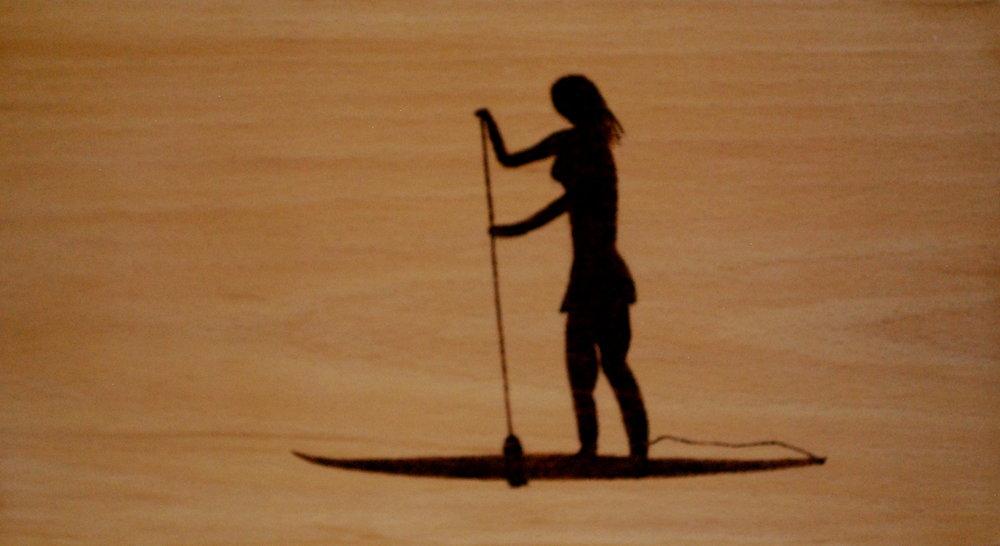 Woman paddle bording