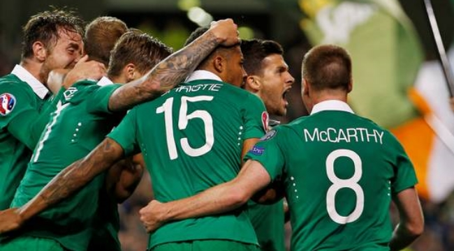 History: Shane Long celebrates with teammates after scoring for the Republic of Ireland against Germany en route to qualifying for Euro 2016