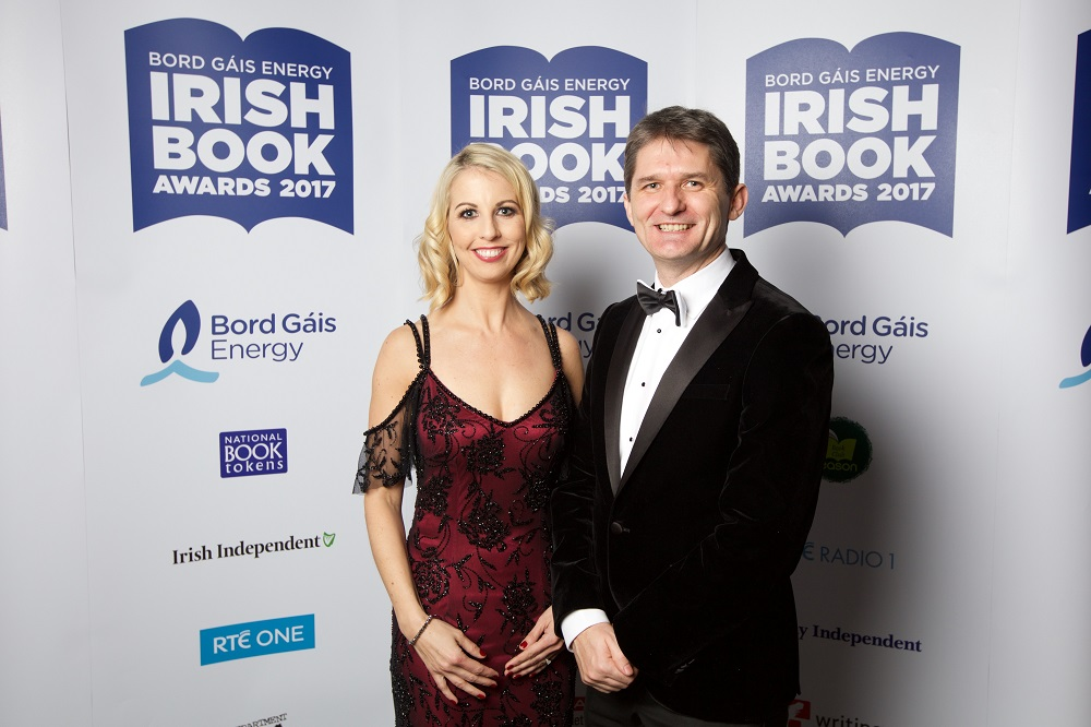 28/11/2017 NO REPRO FEE. Pictured at the Bord Gáis Energy Irish Book Awards which took place on Tuesday, 28th November in The Clayton Hotel, Burlington Road were Catriona Perry and John Trainor Celebrating its twelfth anniversary this year, the Bord Gáis Energy Irish Book Awards has become the major event in the literary calendar with some of Ireland's, and indeed the world's, most recognised authors gathering together in a spirit of camaraderie and friendly competition to celebrate the success of the past year. This year, over 50,000 readers and book lovers made their voices heard and voted to select the winners in each category.  The awards ceremony was presented by Keelin Shanley accompanied by green room presenter Evelyn O' Rourke. Highlights from the awards ceremony including exclusive back stage interviews will be broadcast during the primetime slot of 9:30pm, the night following the awards, on Wednesday, 29th November 2017.  www.bgeirishbookawards.ie #BGEIBA @BGEIBAS For further details, please contact: Breda Brown / Aisling Hinchy Unique Media 01 5225200/ 087 6966 884 (AH) Pic: Patrick Bolger Photography