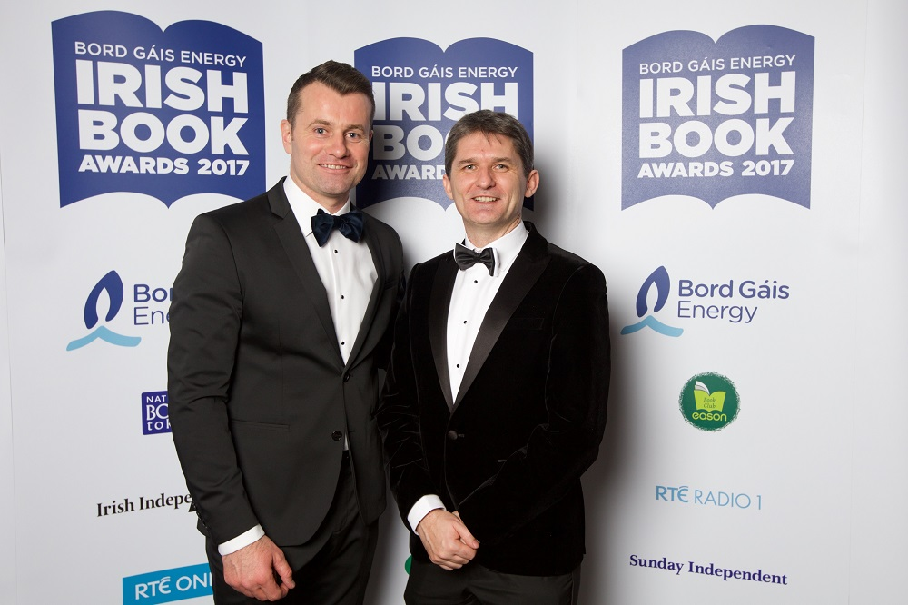 28/11/2017 NO REPRO FEE. Pictured at the Bord Gáis Energy Irish Book Awards which took place on Tuesday, 28th November in The Clayton Hotel, Burlington Road were Shay Given and John Trainor Celebrating its twelfth anniversary this year, the Bord Gáis Energy Irish Book Awards has become the major event in the literary calendar with some of Ireland's, and indeed the world's, most recognised authors gathering together in a spirit of camaraderie and friendly competition to celebrate the success of the past year. This year, over 50,000 readers and book lovers made their voices heard and voted to select the winners in each category.  The awards ceremony was presented by Keelin Shanley accompanied by green room presenter Evelyn O' Rourke. Highlights from the awards ceremony including exclusive back stage interviews will be broadcast during the primetime slot of 9:30pm, the night following the awards, on Wednesday, 29th November 2017.  www.bgeirishbookawards.ie #BGEIBA @BGEIBAS For further details, please contact: Breda Brown / Aisling Hinchy Unique Media 01 5225200/ 087 6966 884 (AH) Pic: Patrick Bolger Photography
