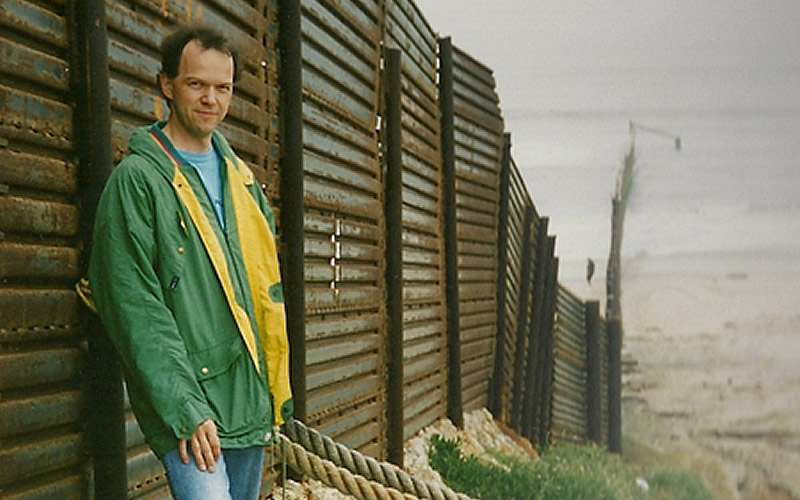 "Rainer Bauböck, Professor at the European University Institute, Florence, Italy, participant in the IVLP ""Migrants and Minorities,"" June 1995, in front of the border fence near San Diego, Cailfornia"