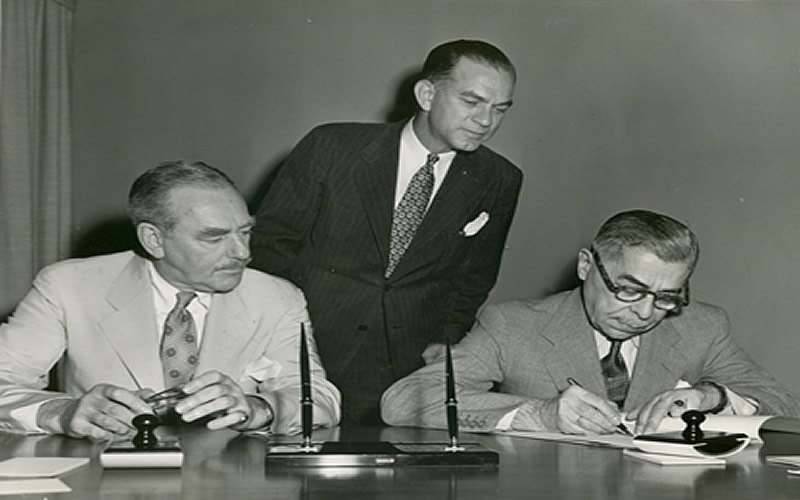 U.S. Secretary of State Dean Acheson, Senator J. William Fulbright, and Austrian Ambassador Ludwig Kleinwächter (from left to right) at the signing of the first agreement to establish Fulbright exchanges between the Republic of Austria and the United States of America on June 6, 1950, in Washington, D.C.