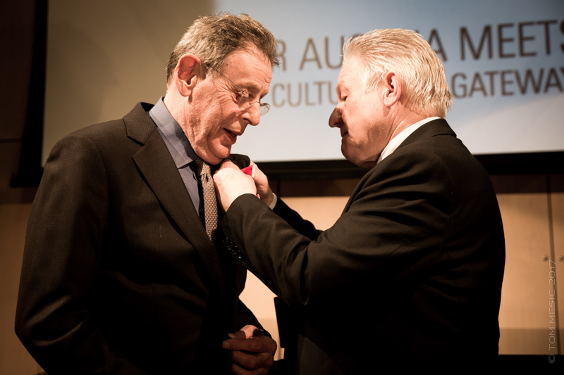 "Governor Josef Pühringer presented the ""Decoration of Honor in Gold of the Federal State of Upper Austria"" to U.S. composer Philip Glass in a private ceremony held at the Austrian Cultural Forum New York on January 30, 2017.  Photo: Tom Mesic"