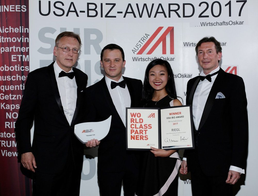 RIEGL accepting the USA Biz Award. From left: Rudolf Thaler (Austrian Trade Commissioner in Los Angeles), Johannes Riegl, Jr. and My-Linh Truong (RIEGL), and Walter Koren (Head of Austrian Foreign Trade Organization). Photo Credit: Jim Lee.