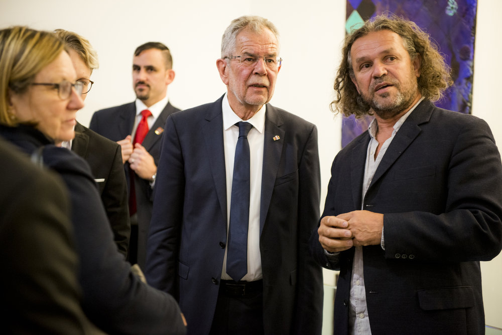 President Alexander Van der Bellen (center) with curator Andreas Reiter Raabe (right) at the  WILD WEST  Opening Reception, September 19, 2017, at the Austrian Cultural Forum New York, Photo: David Plakke/ACFNY