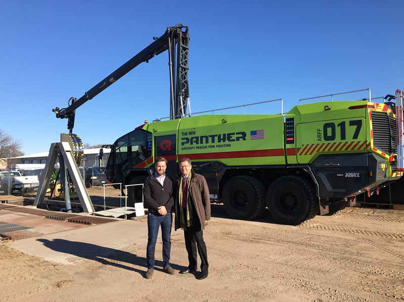 Ambassador Waldner (right) with VP Kirvida of Rosenbauer USA in front of a vehicle of the new Panther - series. Photo: Kurt Witte