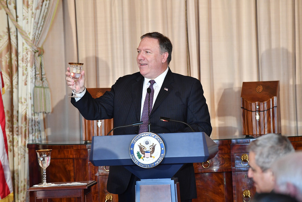 U.S.  Secretary of State Mike Pompeo Proposes a toast during the working  luncheon for the Ministerial to Advance Religious Freedom at the U.S.  Department of State, in Washington, D.C.. [State Department Photo/Public  Domain]