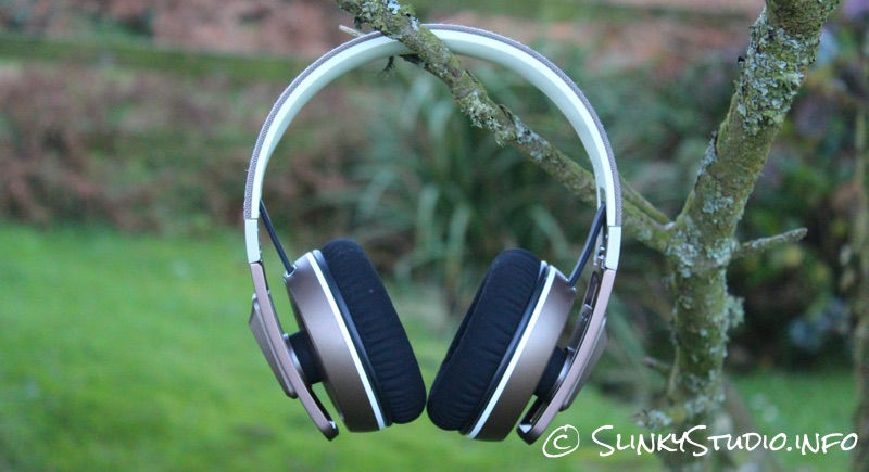 Sennheiser Urbanite XL Headphones Hanging On Tree W: Grass Background.jpg