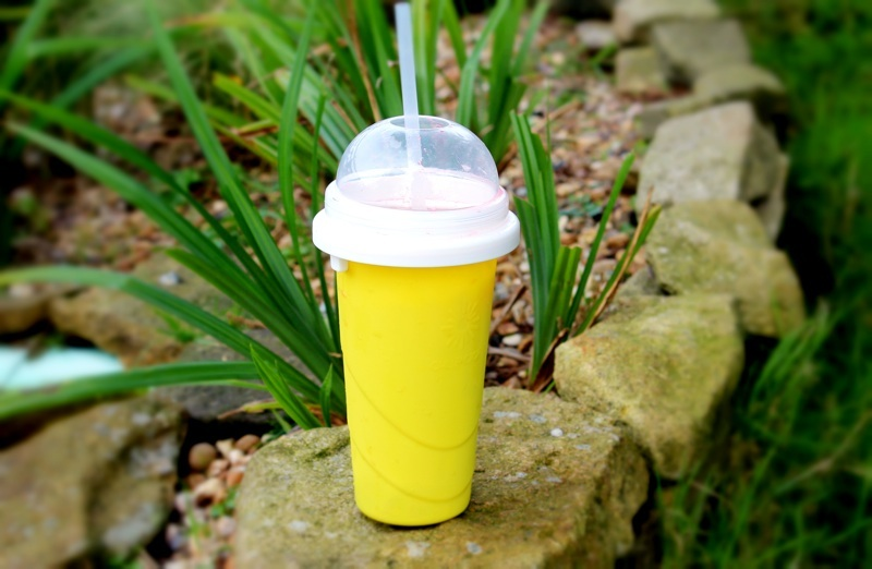 Chill Factor Squeeze Cup Slushy Maker on Rock in Sunshine.jpg