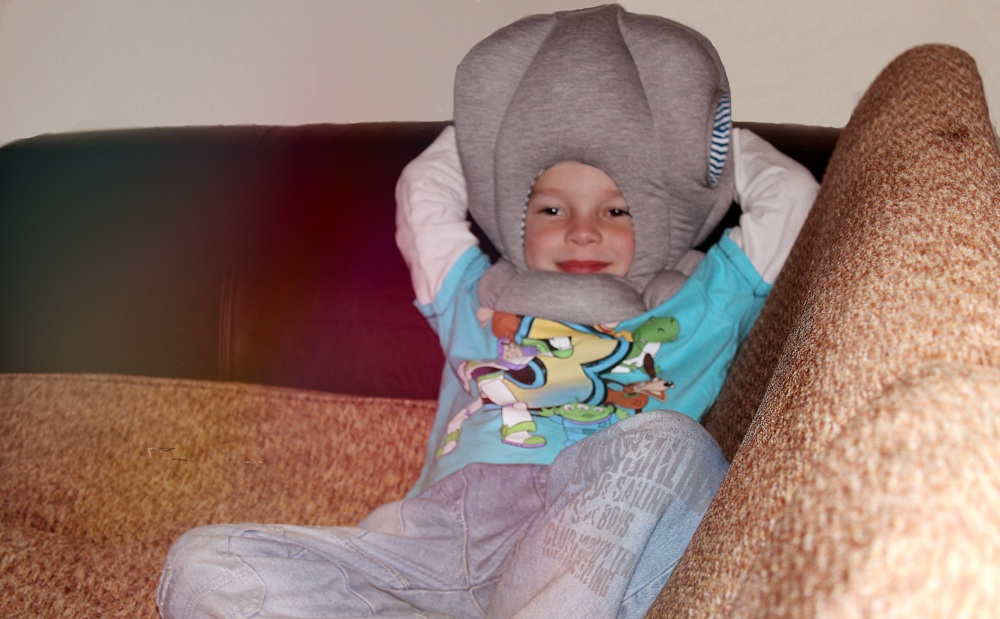Ostrich Pillow Junior Relaxing on Sofa.jpg