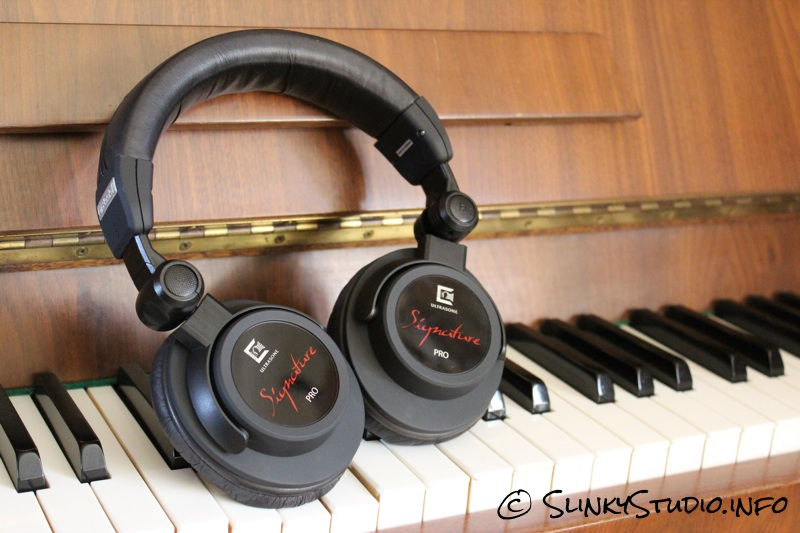 Ultrasone Signature Pro Headphones Cups Folded Flat on Piano.jpg