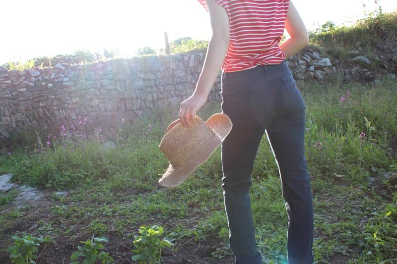 American Apparel Slim Slack Jeans Model Holding Straw Hat.jpg
