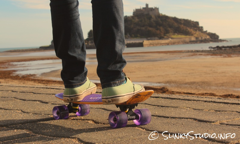 Penny Original Skateboard riding on stone ground: Vans shoes.jpg