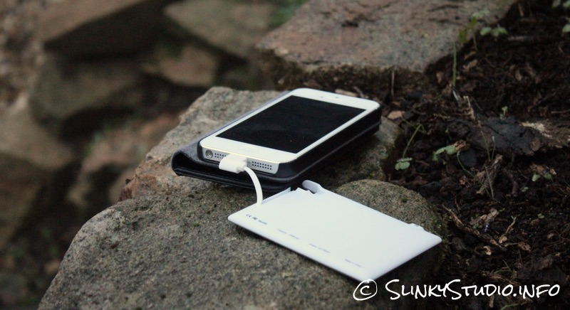 TravelCard Charger Charging iPhone 5 Outdoors on a stone.jpg