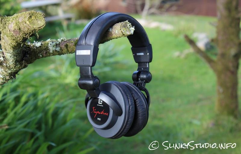 Ultrasone Signature Pro Headphones Hanging on tree branch in garden.jpg