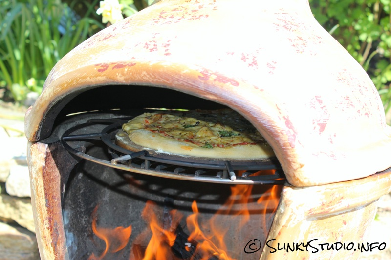 La Hacienda Clay Pizza Chimenea Cooking Pizza Close Up.jpg