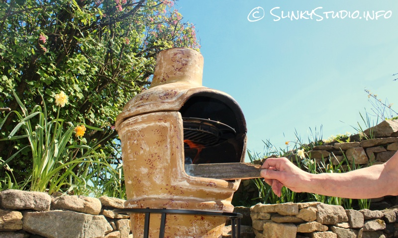 La Hacienda Clay Pizza Chimenea Creating a fire.jpg