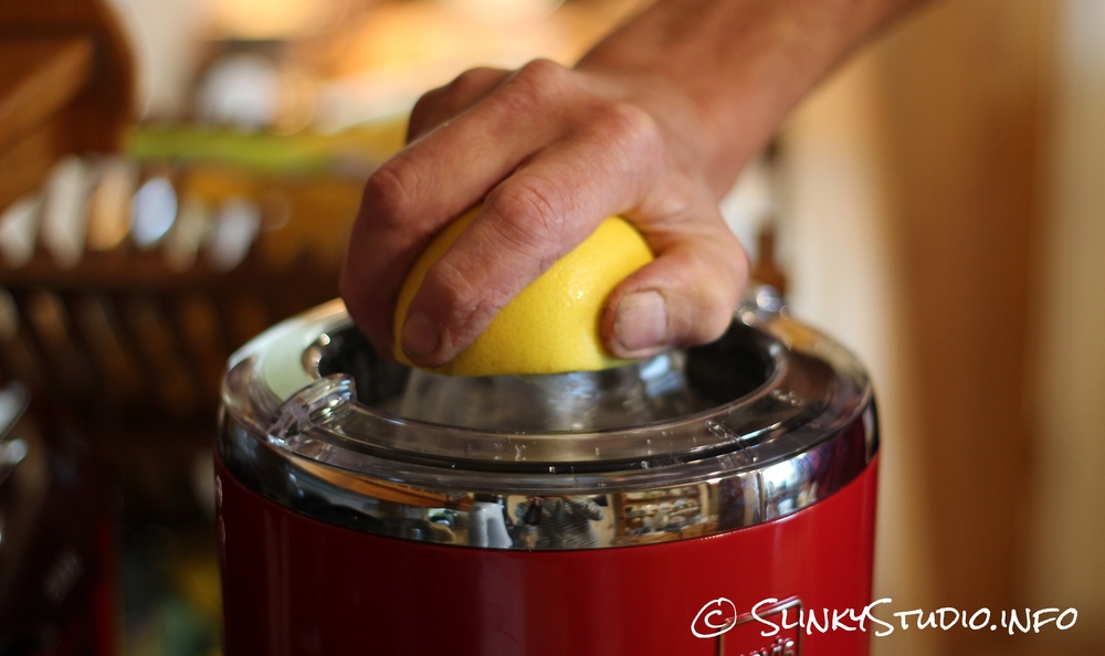 Novis Vita Juicer Citrus Press In Use With Hand -Grapefruit