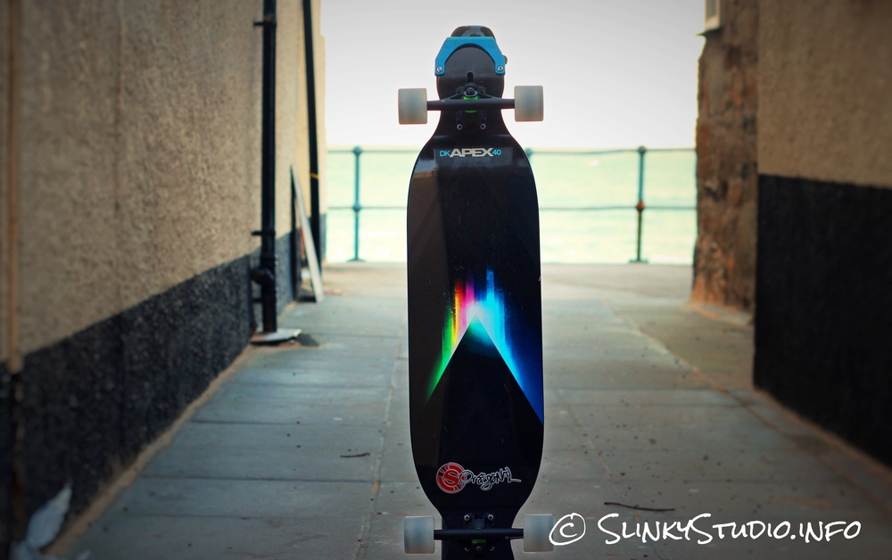Original Skateboards Apex 40 DiamondDrop Longboard Deck Graphic Leaning Against Pillar .jpg