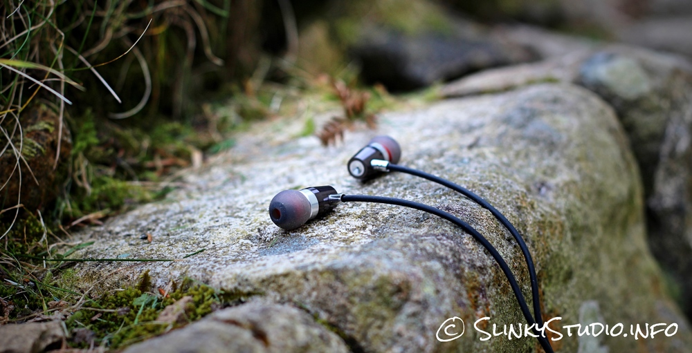 Rock Jaw Alfa Genus V2 Earphones Laying on Stone Side Angle.jpg