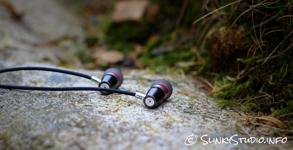 Rock Jaw Alfa Genus V2 Earphones Laying on Stone.jpg