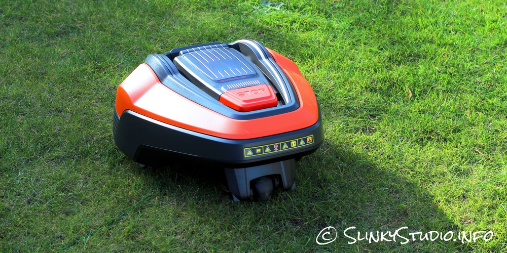 Flymo Robotic 1200R Lawnmower Mowing Lawn Above Back View.jpg