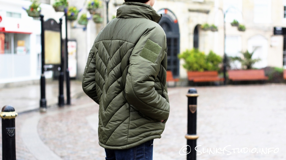 Snugpak SJ6 Jacket Behind View Hands in Pockets.jpg