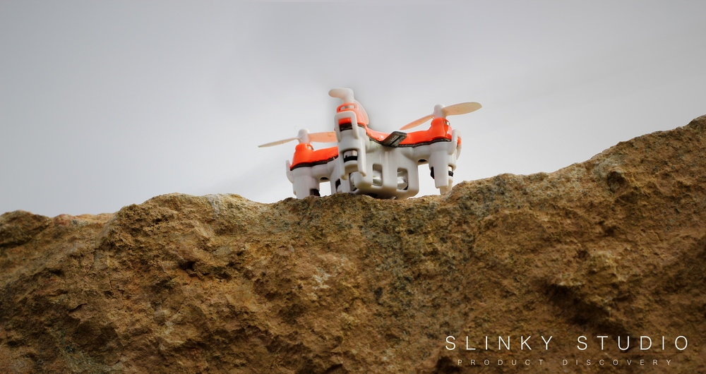 BuzzBee Nano Drone Holding Landed on Rock Looking up at sky.jpg