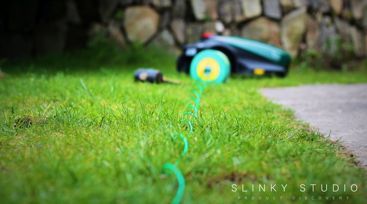 Robomow RC304 Robot Lawnmower Laying Wire.jpg