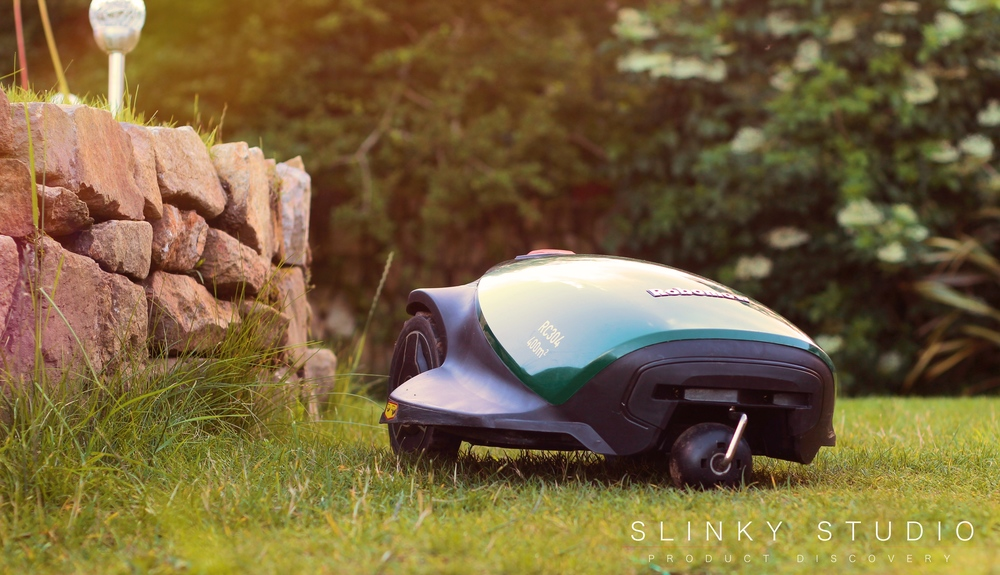 Robomow RC304 Robot Lawnmower Mowing Around Wall Edge.jpg