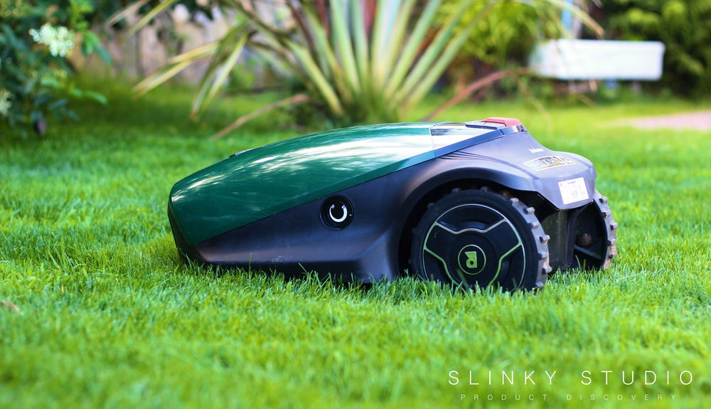 Robomow RC304 Robot Lawnmower Side View Cutting Grass Lawn.jpg