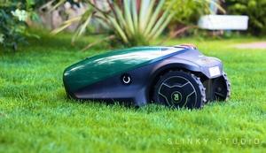 Robomow RC304 Robot Lawnmower Side View Cutting Grass Lawn.jpg