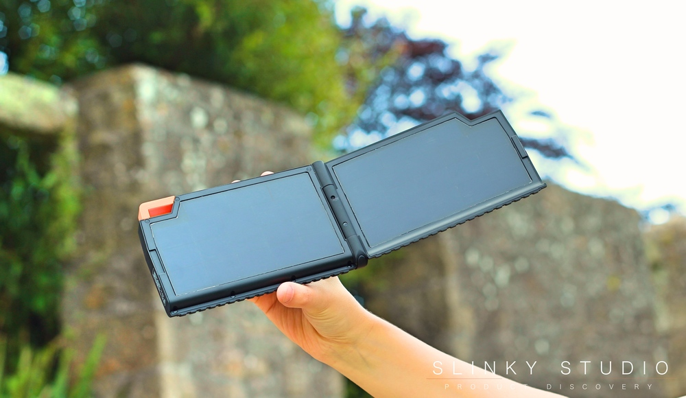 Xtorm Evoke Solar Panel Charger Open Holding in Air.jpg