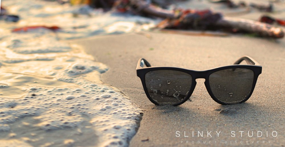 SunGod Classics² Sunglasses Lying on Beach with tide Approaching