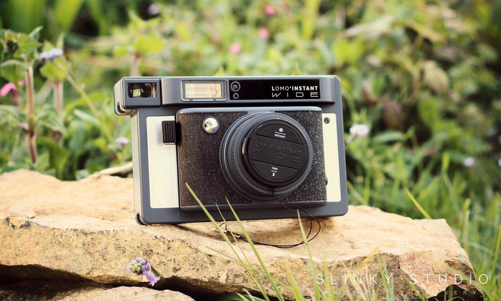 Lomography Lomo'Instant Wide Camera Sitting on Rock Outdoors.jpg