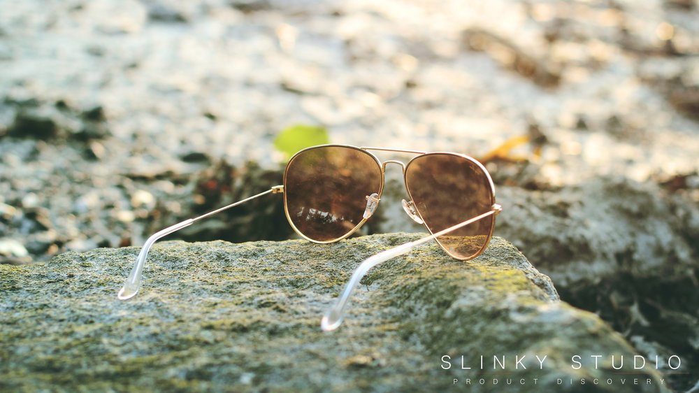 Ray Ban Aviator Sunglasses RB3025 Resting on Stone at Beach.jpg