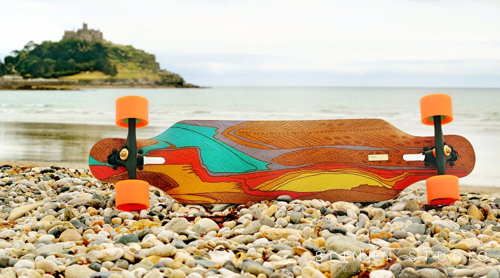 Loaded Icarus Longboard Lying on Pebal Beech.jpg