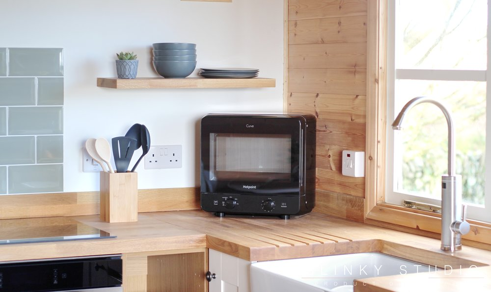 Hotpoint Curve Microwave on Oak Worktop in Shaker Styled Kitchen