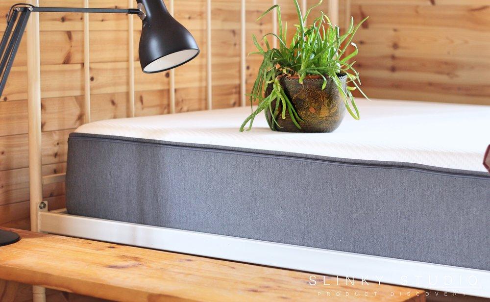 Casper Mattress Side Grey Angle Plant on Bed.jpg